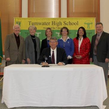 In December 2016, Melissa Determan Beard and the Tumwater School Board joined Tumwater Supt John Bash and State Supt. Randy Dorn as he signed the new Computer Science Standards at Tumwater High School.